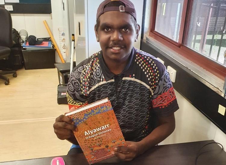 Senior student translates board book into first language